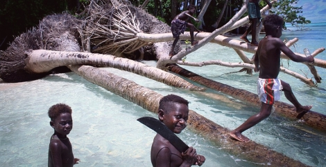 Carteret Atoll children playing on storm-damaged trees. Image Courtesy: Tulele Peisa.