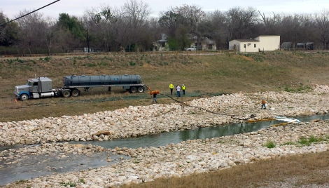 A vacuum truck being used to remove spilled fuel from the San Antonio River earlier this year.