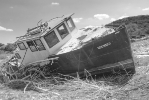 During the 2011 Texas drought, many of the waterways dried up across the state. This boat was left to sit in the middle of what is normally a branch of Lake Travis, part of the Colorado River. Image: Erik Ellison.