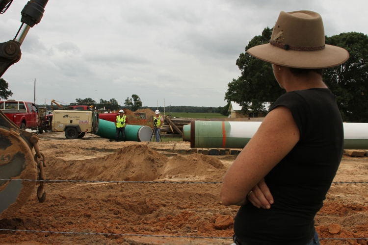 Julia Trigg Crawford (foreground) says Keystone pipeline crew members on her Northeast Texas farm would train a video camera on her whenever she photographed their work.