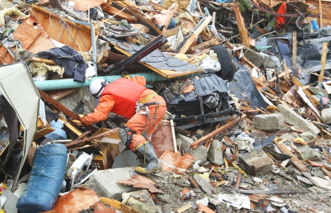Rescue teams searching for missing people in Natori, Japan, 2011. Image: Iliya Pitalev